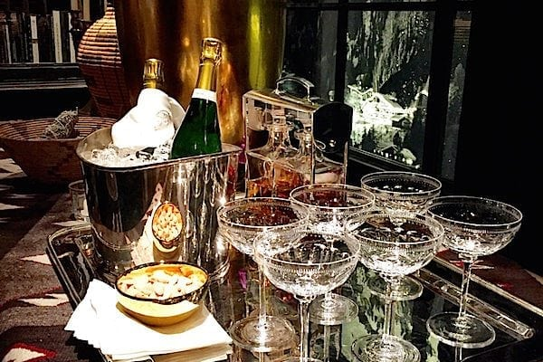 Clear wine glasses on tray near window