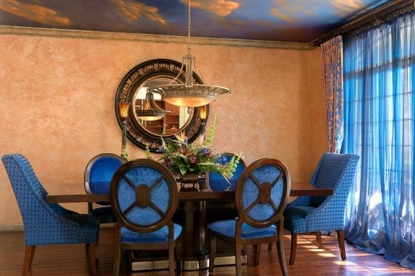 Designed to mimic a Tuscan sunset, this dining room's deep blue