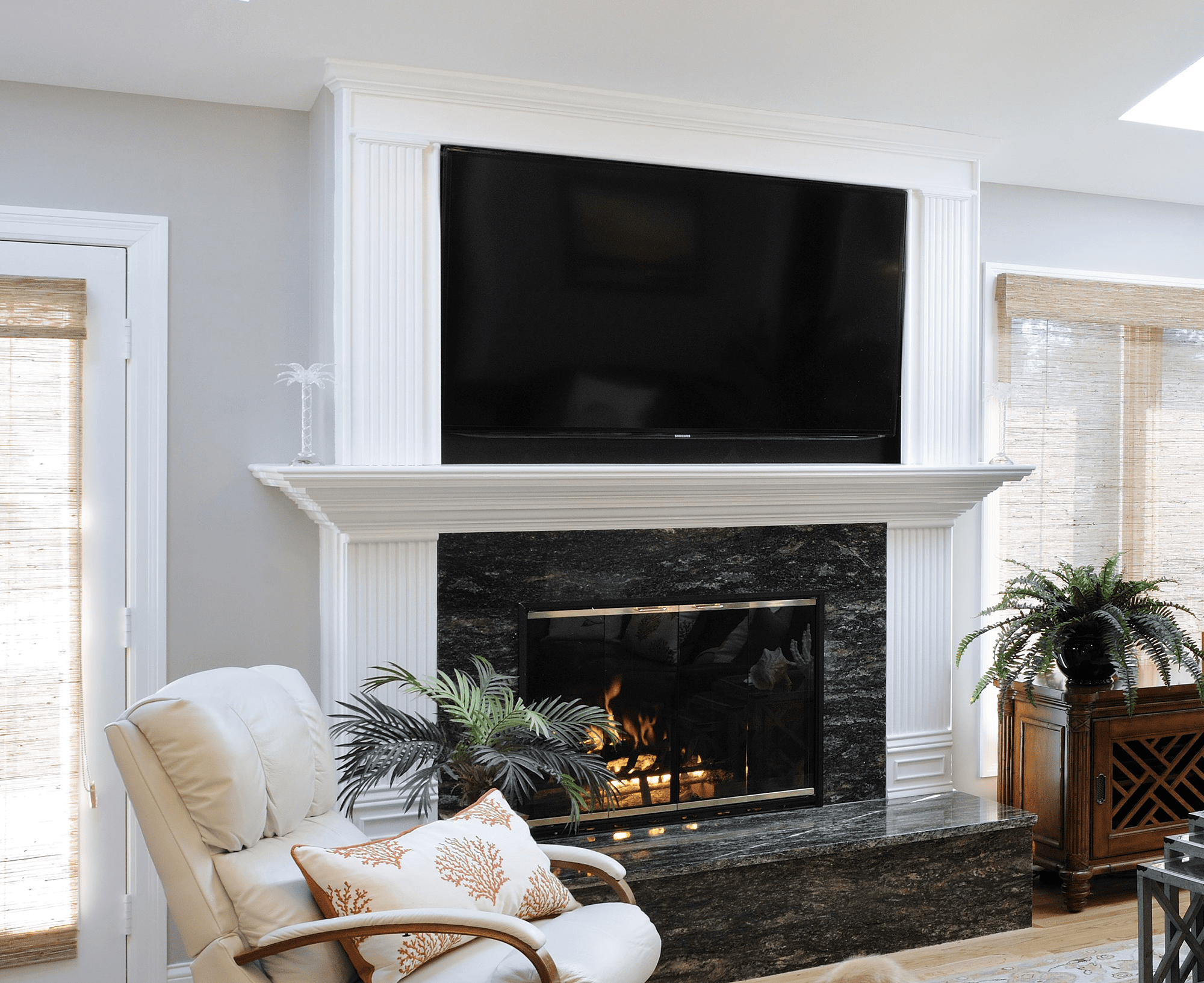 Gray rolling armchair near electric fireplace