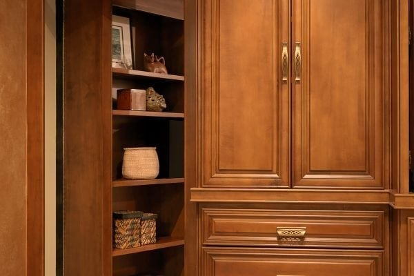 bookcase opens on a piano hinge to access electronics wires. The space is large enough for secret storage also.