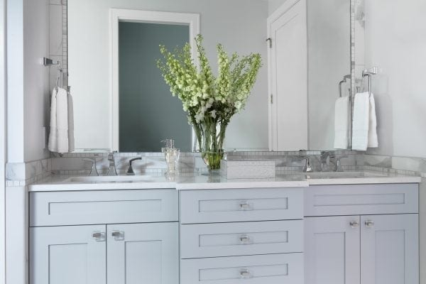 custom painted vanity in a soothing light blue complements the dramatic tile work.