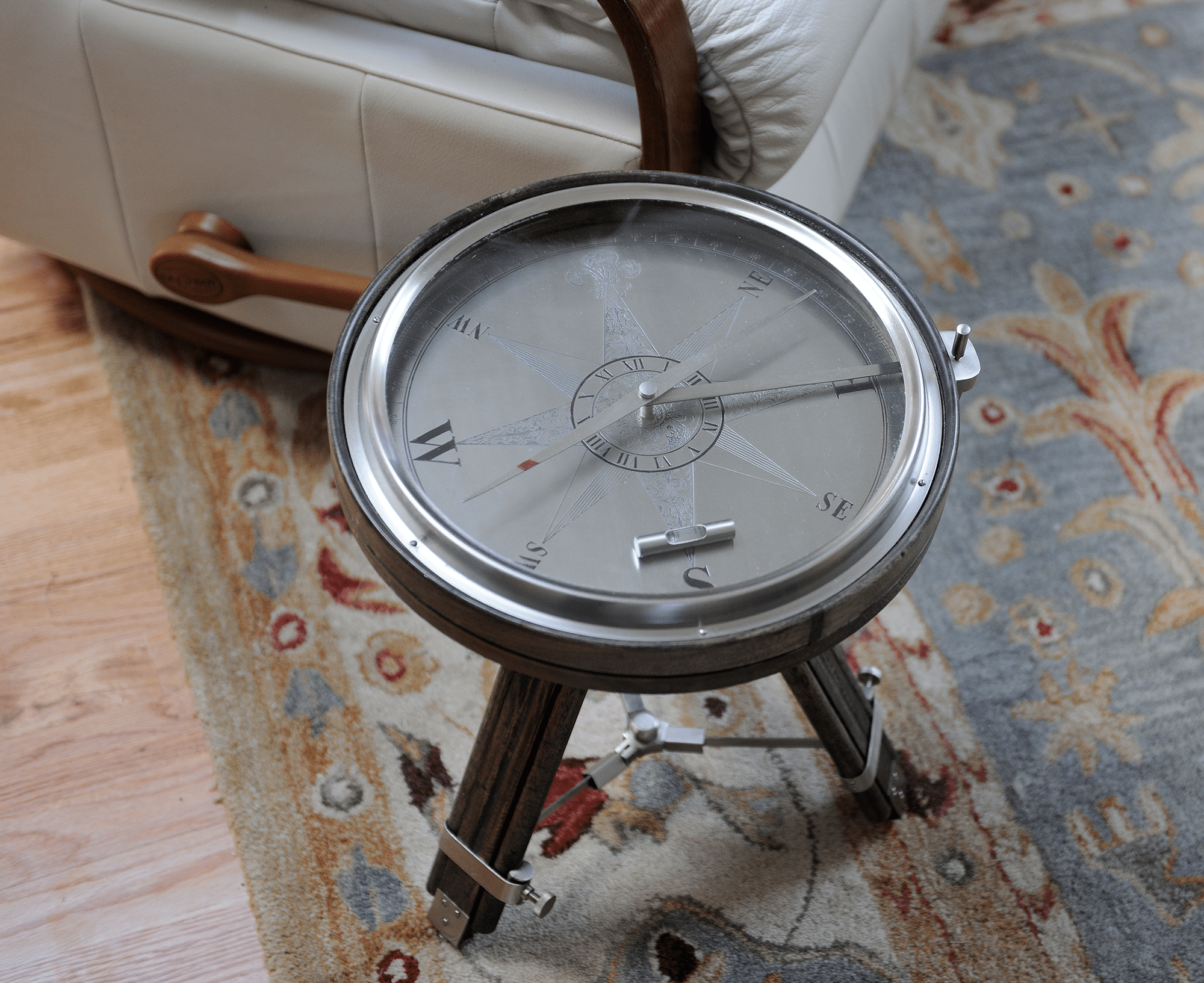 Round grey compass pointing South South West