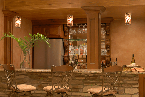 Three gray metal bar stools beside bar counter in room