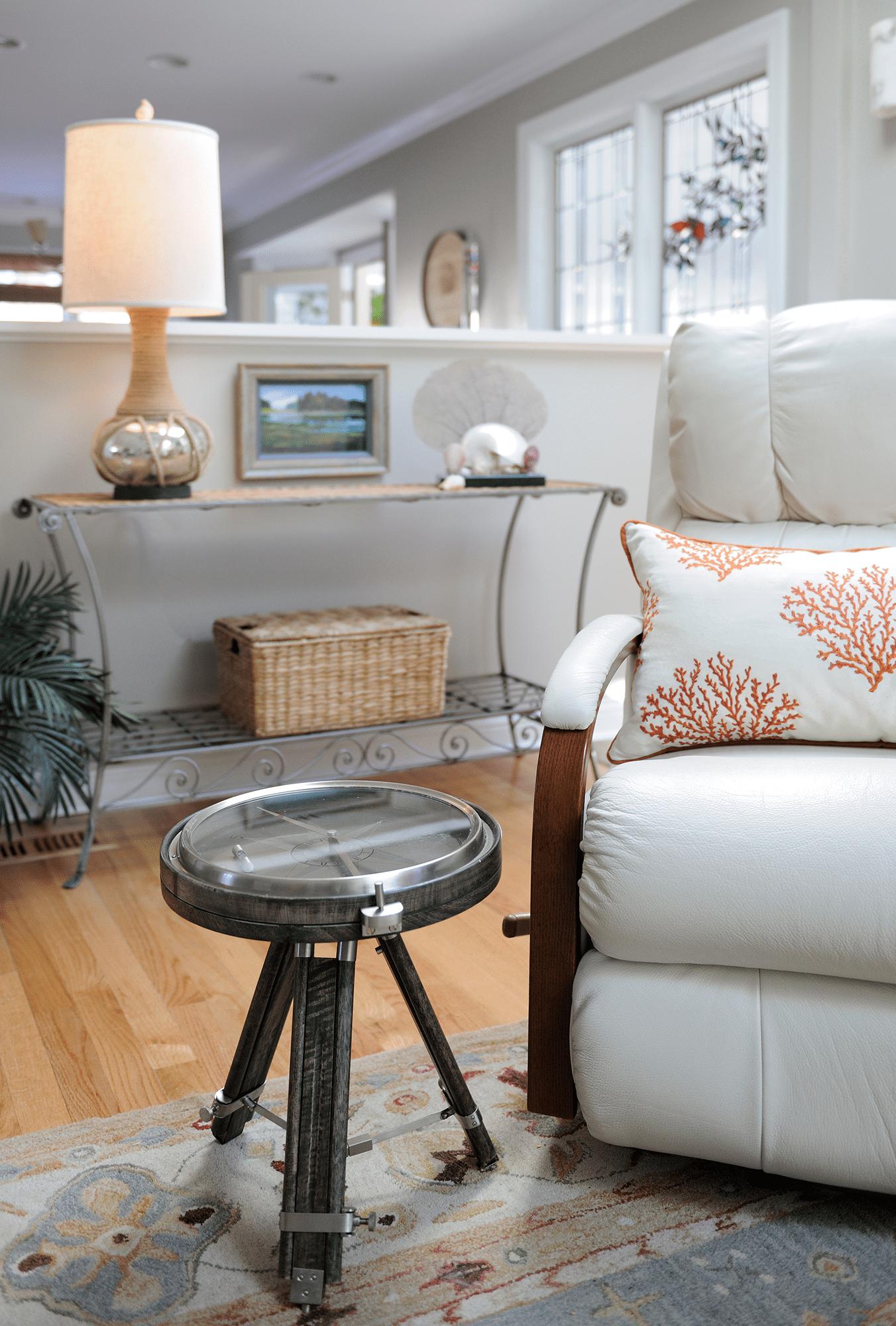 Glass-top stool near sofa