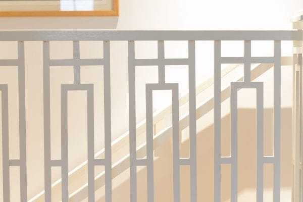 Photo of white wooden handrail