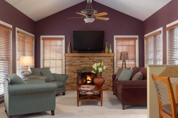 Paint and new fireplace stone take this hearth room from starkly uninviting to warm and cozy.