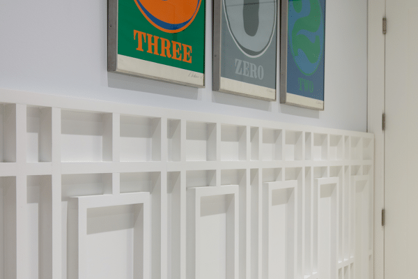 Three assorted-color steel wall decorations