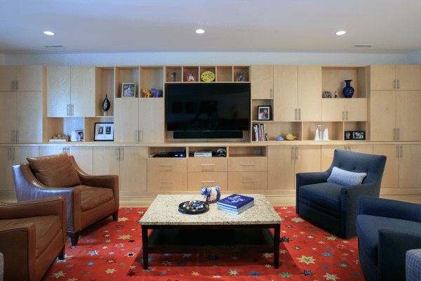 Flat screen TV on brown wooden home entertainment center