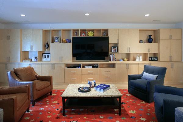 Flat screen TV in front of sofa set