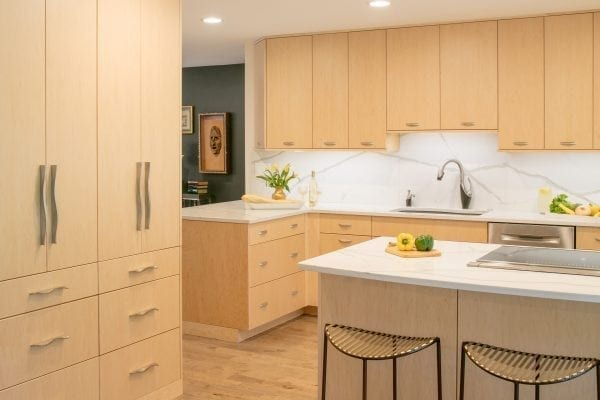 Another step in creating a cohesive look was the new engineered hardwood floor, running throughout the kitchen, dining and living room and down the hall.