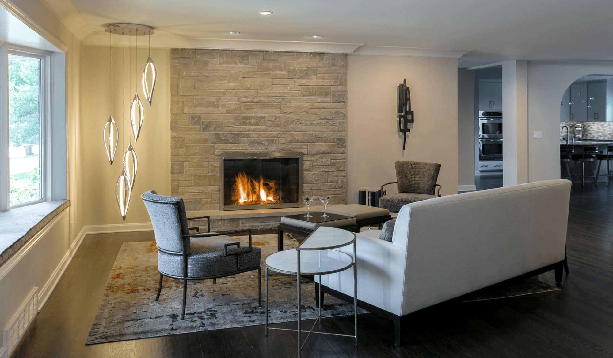 Gray sofa and fireplace turned on