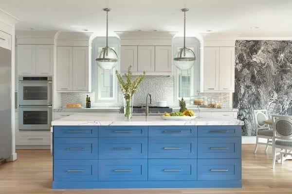 Empty blue and white wooden island kitchen