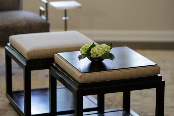 coffee table cubes do double duty as ottomans by flipping the top. Feet up, drinks down.