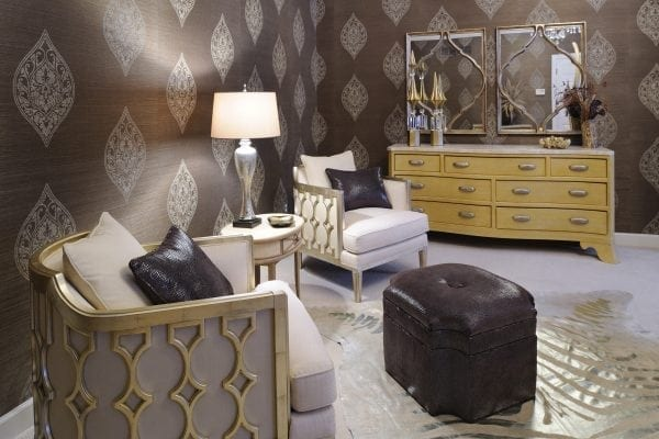 wallpaper medallion is mimicked in mirrors and chair detailing.