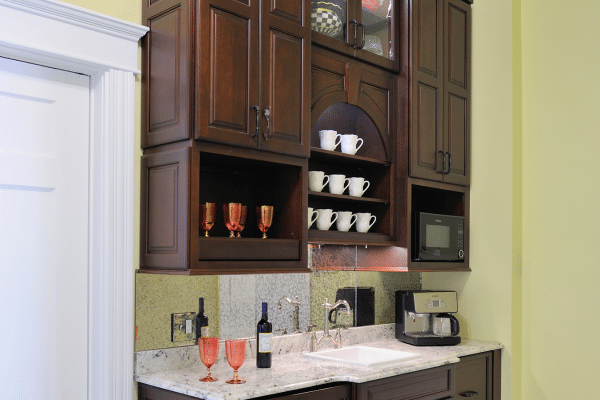 Brown wooden vanity combo and cabinet inside room