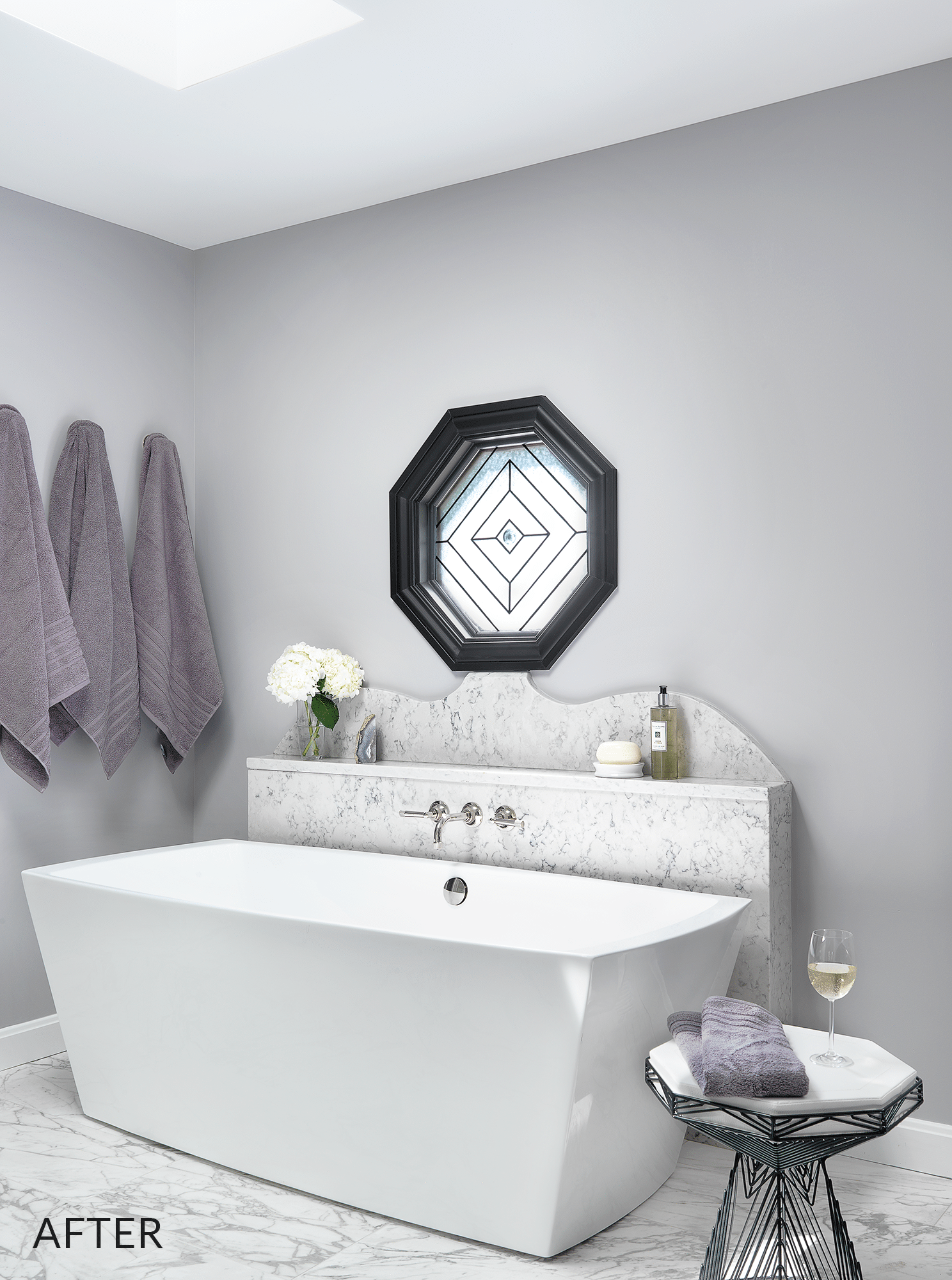 Three gray bath towel hung near bathtub