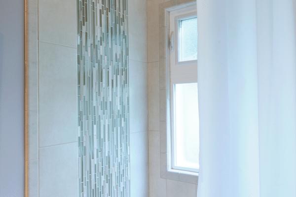 Chrome shower near window