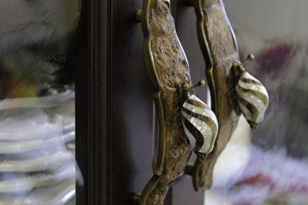 the dark china cabinet next to the breakfast nook has these wondrous handles.