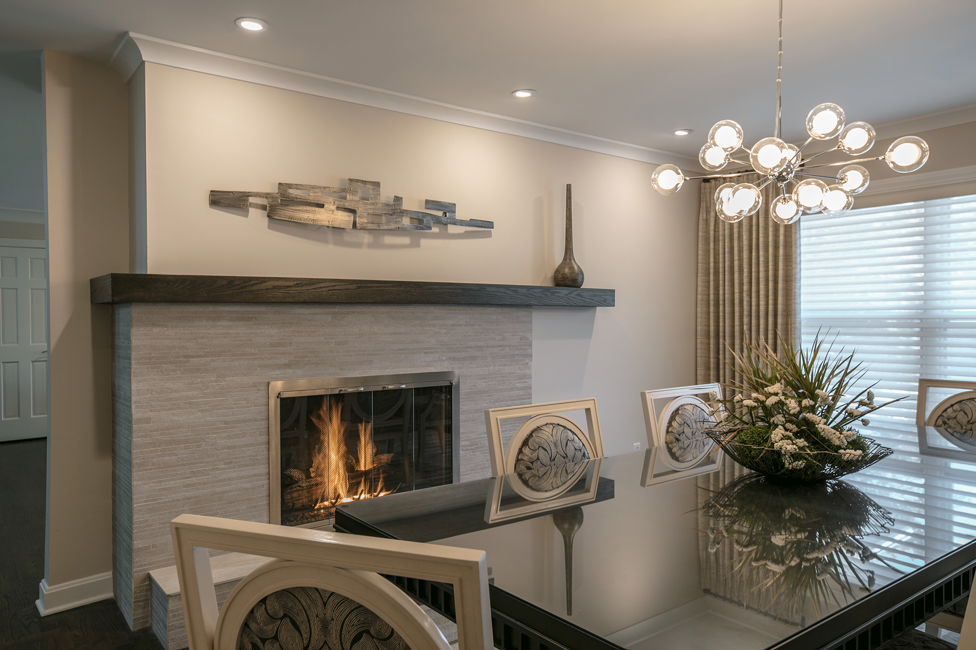 White chandelier and fireplace
