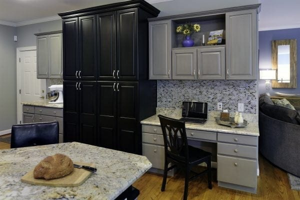 existing cabinets were painted gray and black. A new countertop and backsplash were added.