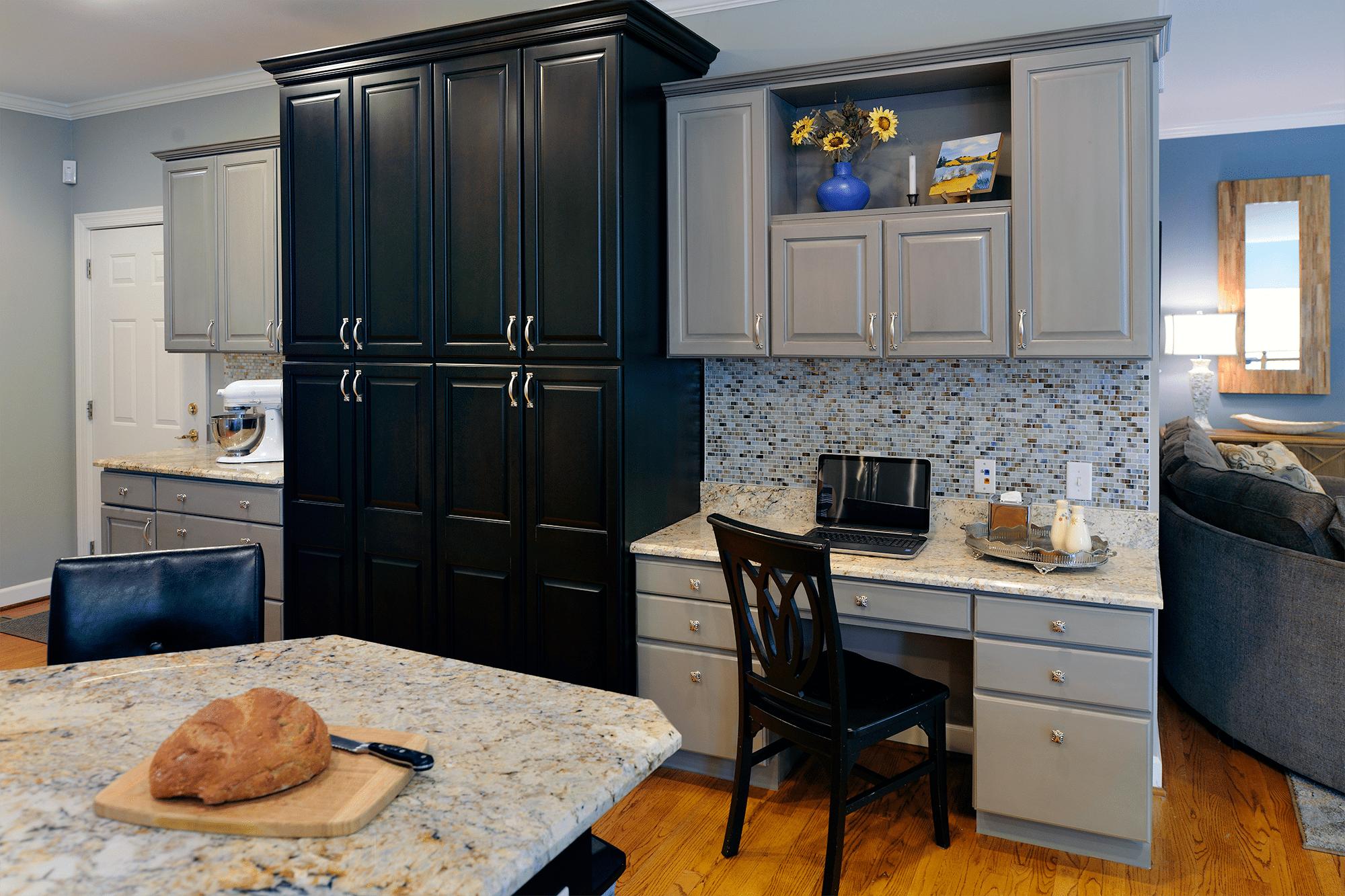 Bread on chopping board near cabinet