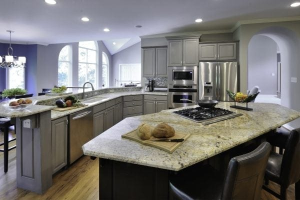 existing cabinets painted gray, island painted black, new countertop, new backsplash – feels like an entirely new kitchen.