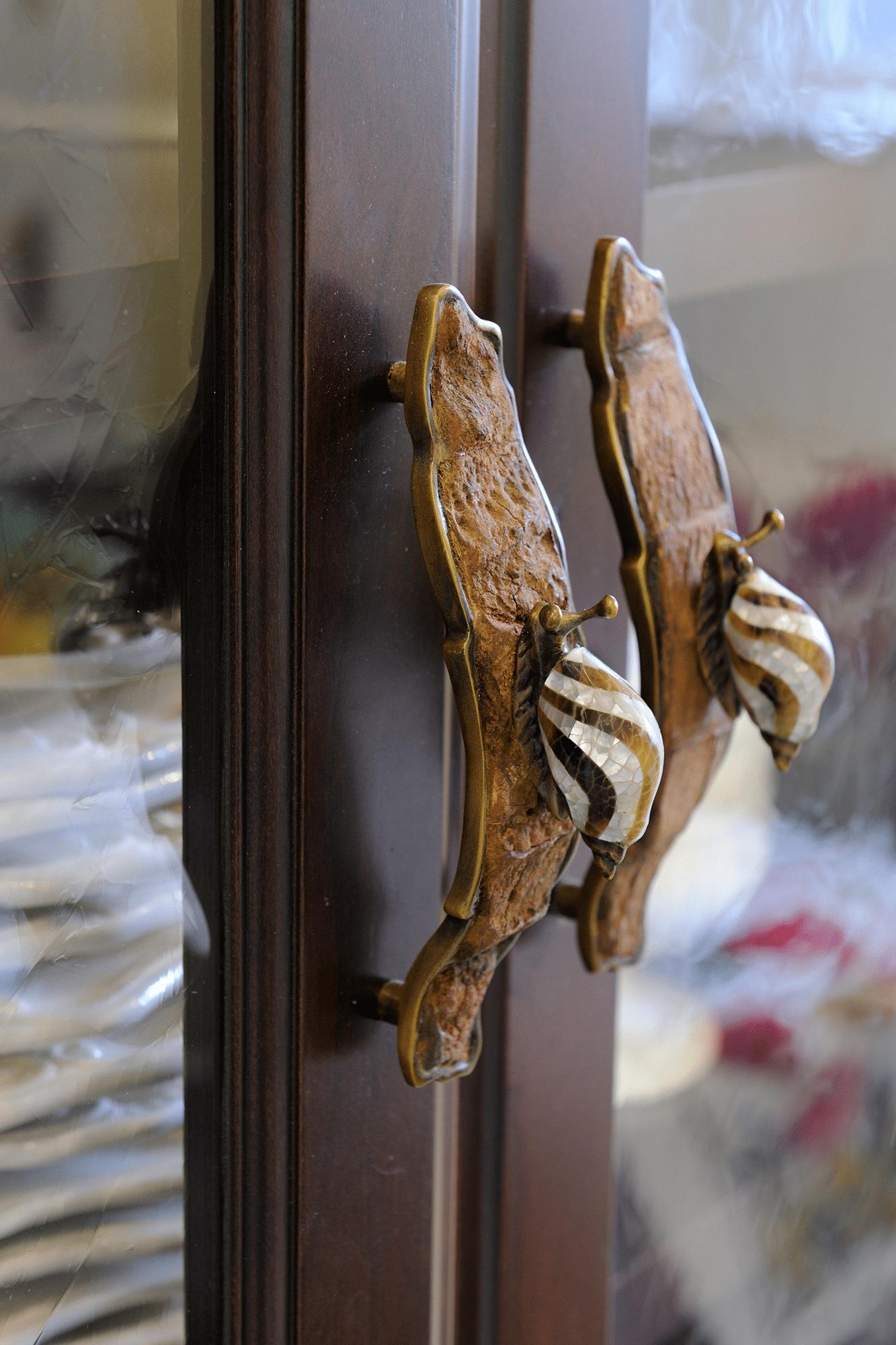 two brown metal snail door handles