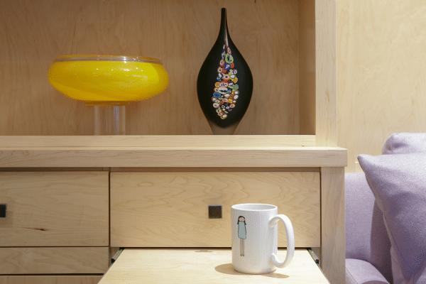 White ceramic mug on drawer inside room