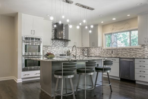 existing island cabinets painted gray, all other cabinets painted white. The snowball pendants are so fun! The bar stools add a little bit of a '50s diner look. ASID Pinnacle Award, Kitchen Design