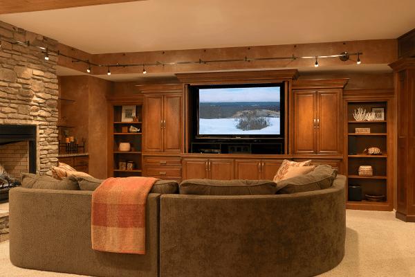 Black flat screen TV on wooden entertainment center