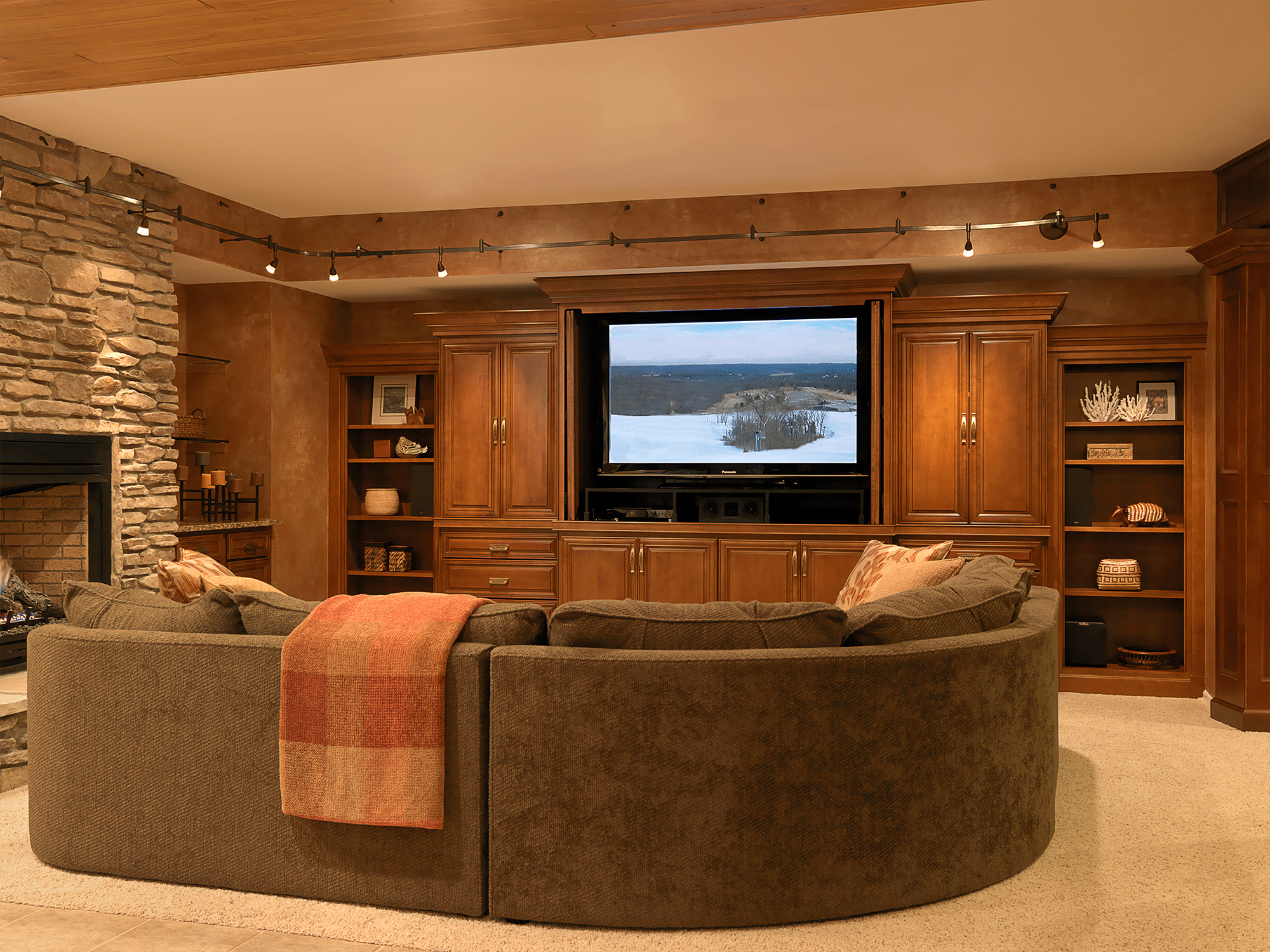 Black flat screen TV on wooden entertainment center