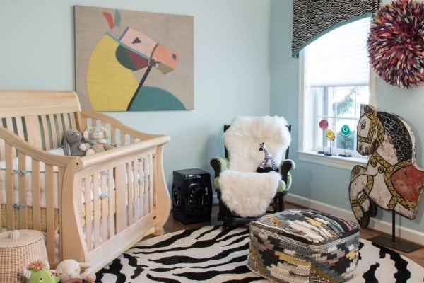 a new baby required the office to morph into a nursery! Whimsical objets d'art will entrance a child but also work in a refurbished office a few years down the road.