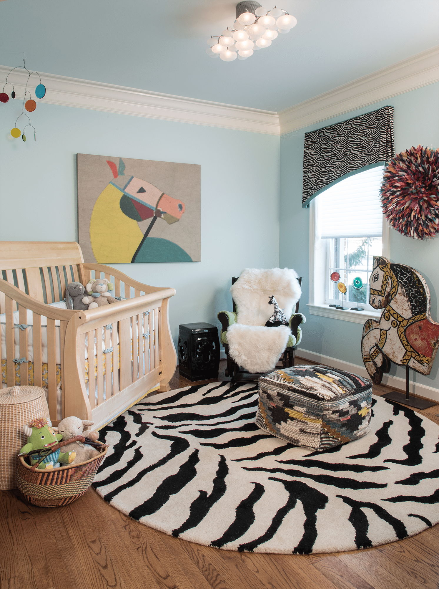 Brown wooden crib and mattress inside well lit room
