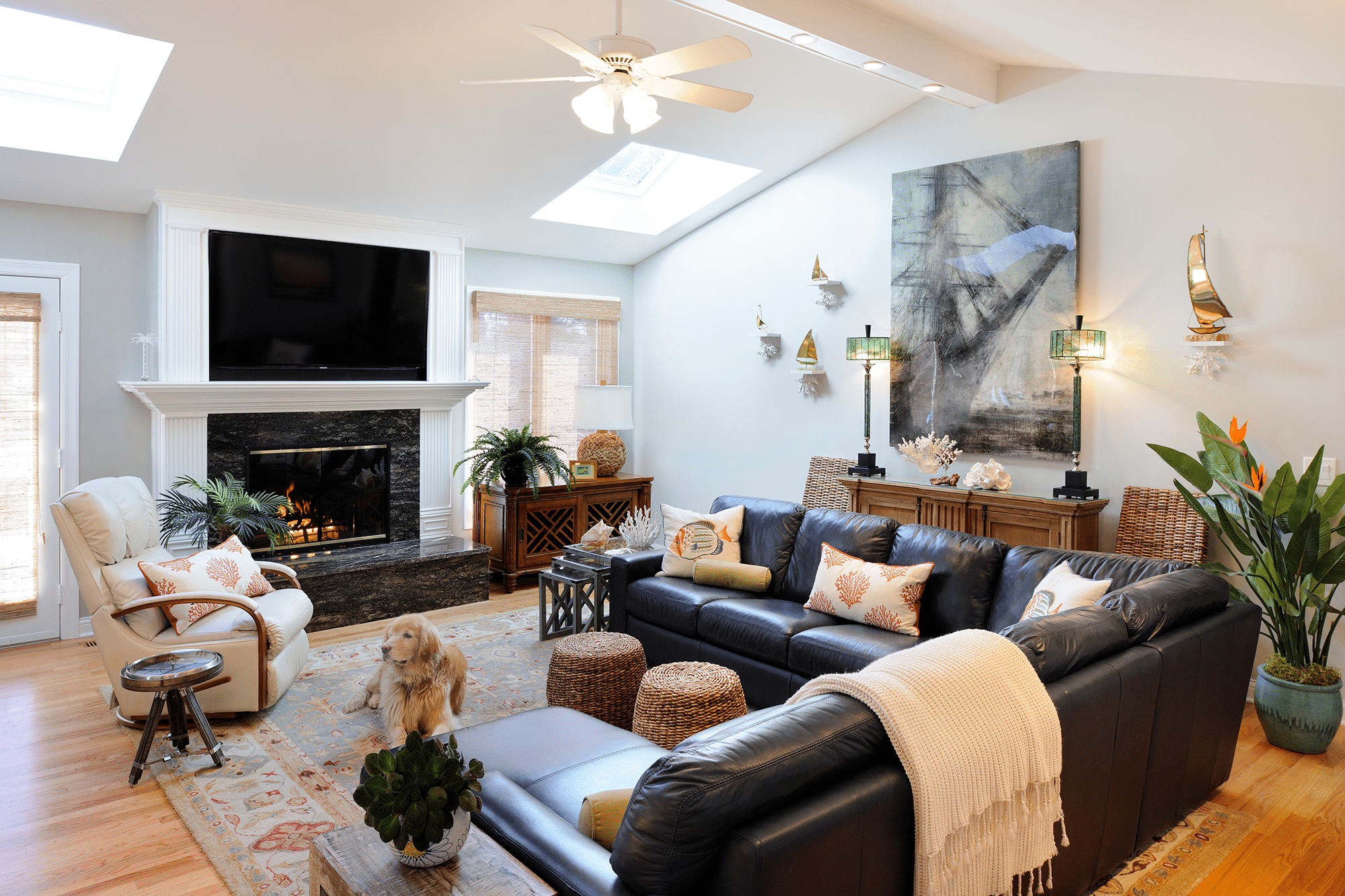 Black leather sectional sofa facing lit electric fireplace