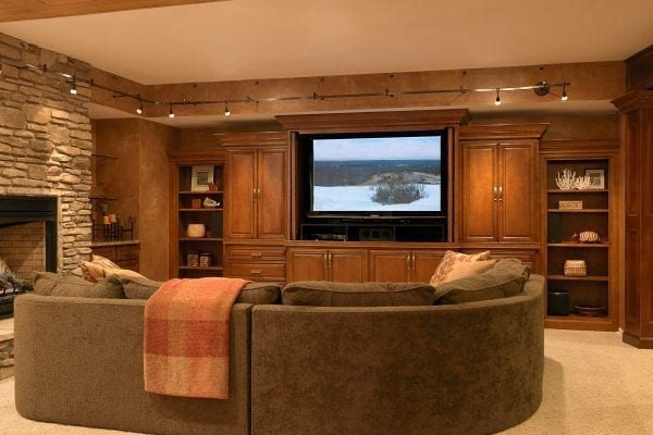 perfect for adult parties with a custom entertainment center and fireplace. pillared walkway accesses a billiard room.