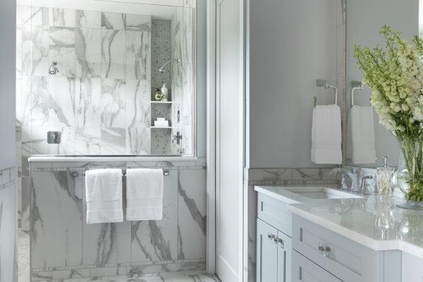 classic marble-like porcelain tile unifies the space. ASID Pinnacle Award, Bathroom Design