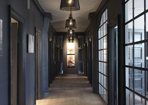 Brown wooden hallway in between doors and glasses