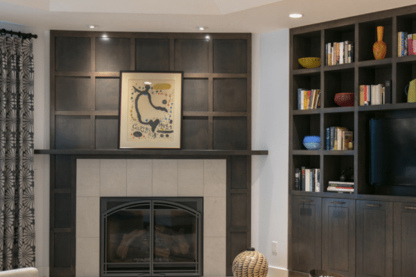 A unique and custom surround that mimics the bookcases makes this fireplace a standout. 
