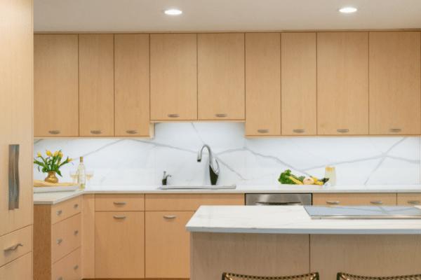Brown and white wooden kitchen furniture set in kitchen
