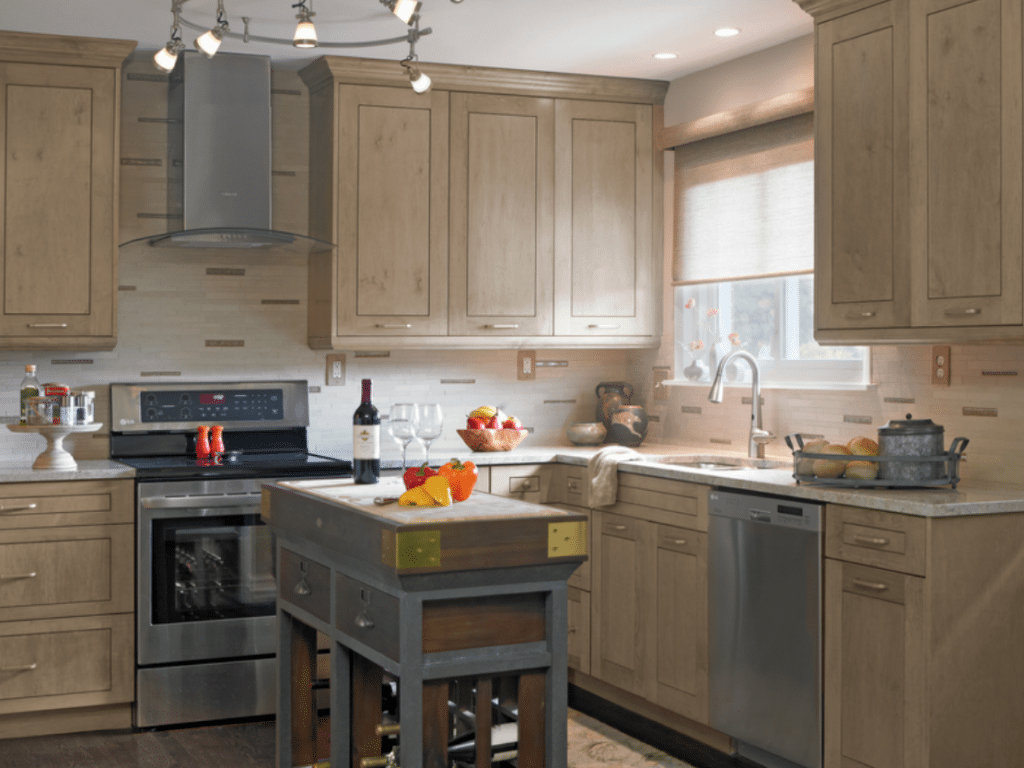Gray and black induction range on kitchen cabinet
