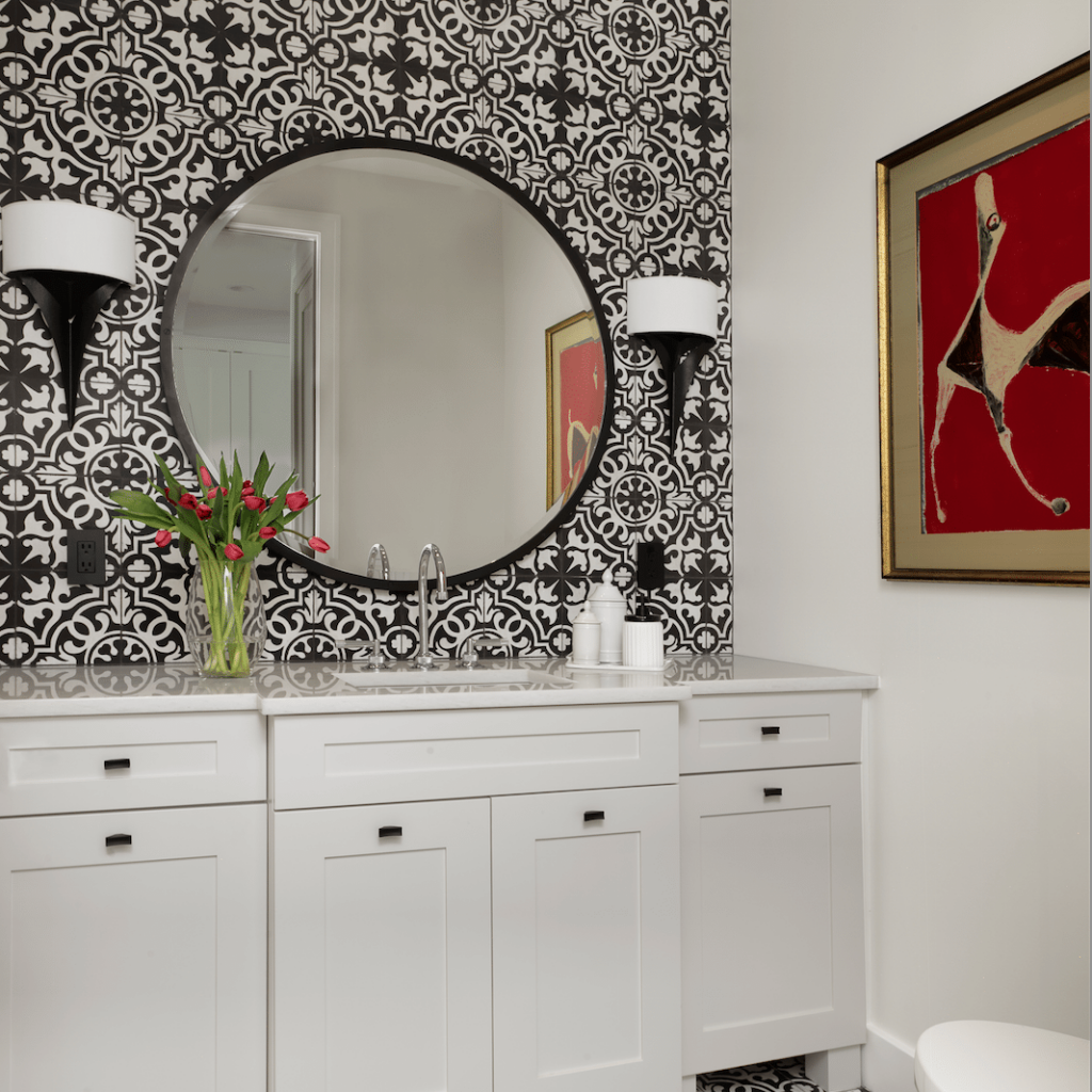 White, black and a touch of red is classic, timeless and always on point, as in this striking powder room I designed for a client who wasn't afraid to push the design envelope. Design by Marcia Moore Photo by Alise O'Brien