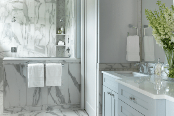 Awash in soft colors and luxurious finishes, this master bath is a true retreat. Photo by Alise O'Brien