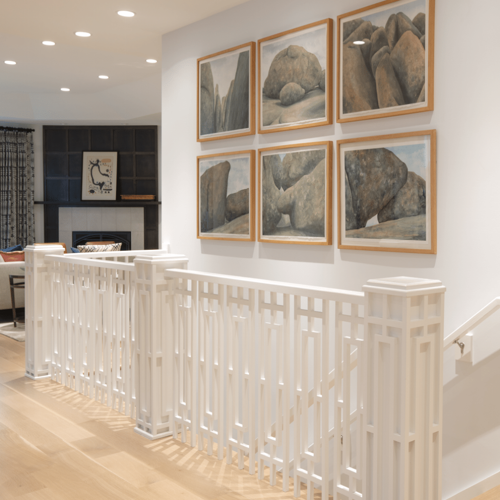 White walls allow artwork to take center stage as in this gallery of prints we created in a new home. Design by Marcia Moore Photo by Suzy Gorman