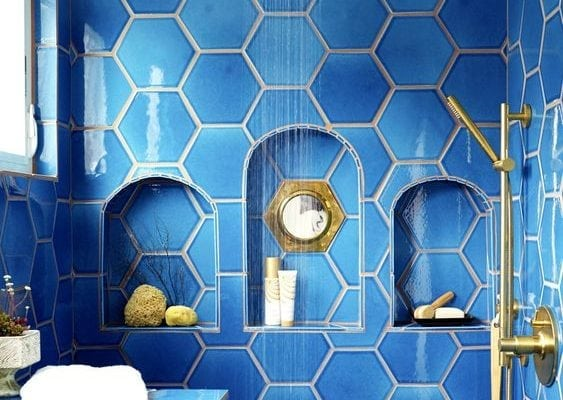 A shower wrapped in gorgeous blue hexagonal tile? Yes, please. House Beautiful