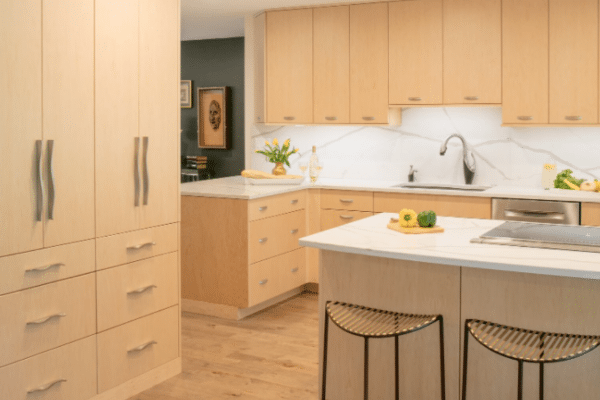 Beige wooden cupboard closed inside kitchen room
