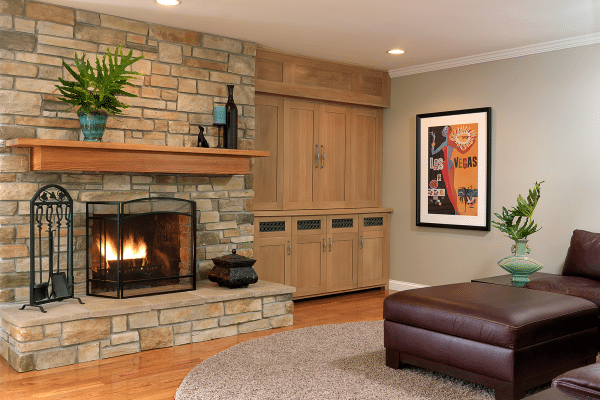 Black fireplace beside brown wooden wardrobe