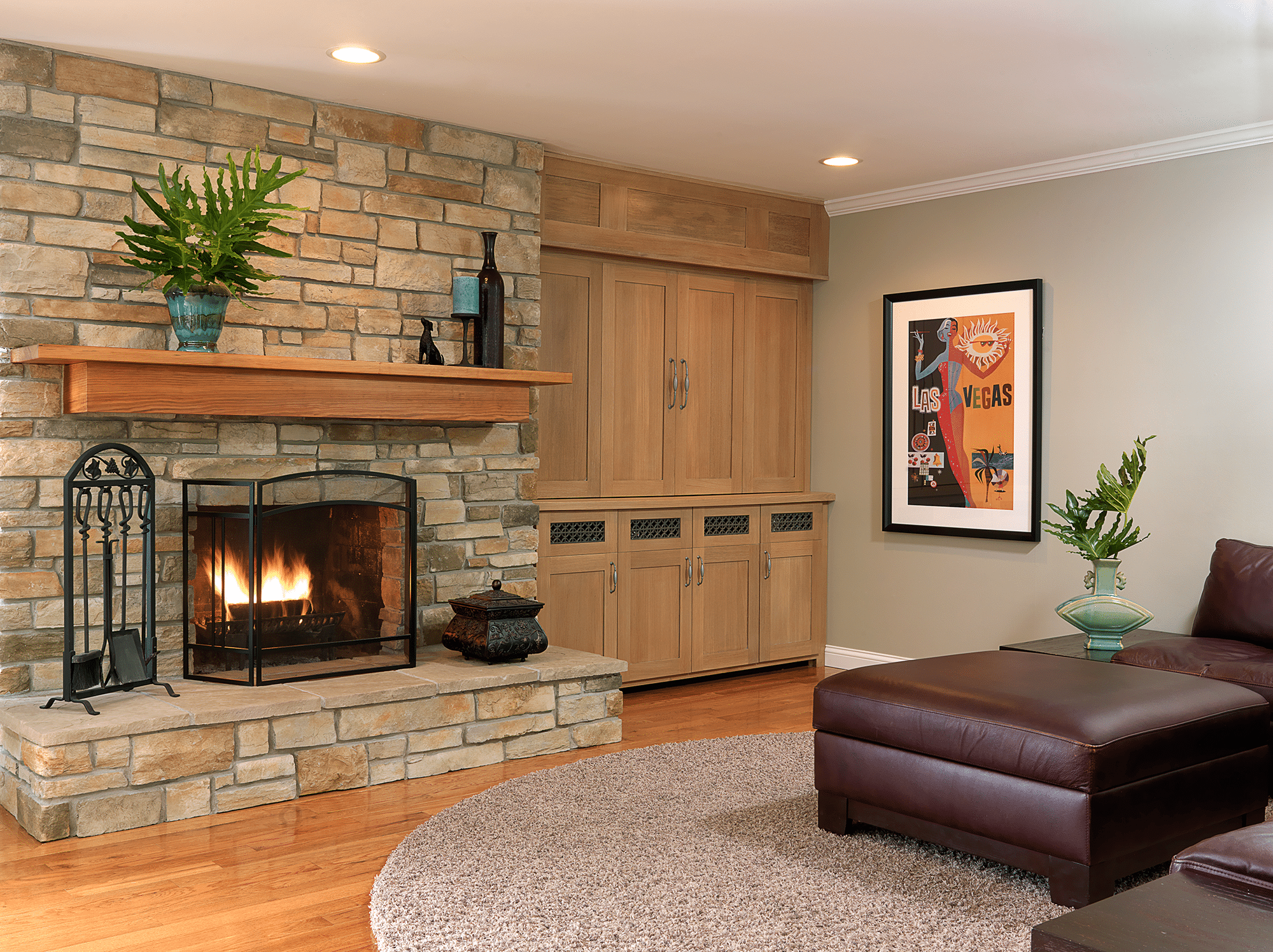 Black fireplace beside brown wooden wardrobe