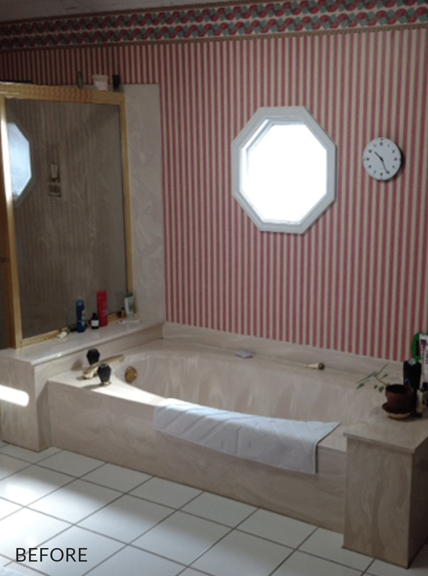 marble bath tub below octagon window