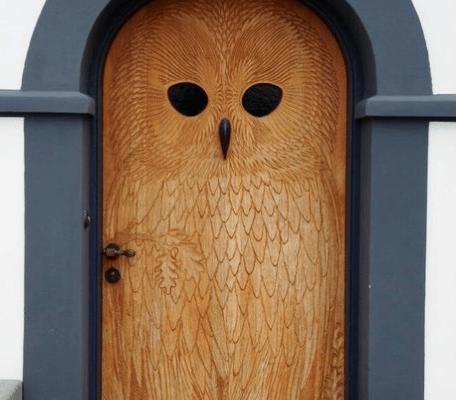 Closed brown wooden owl door