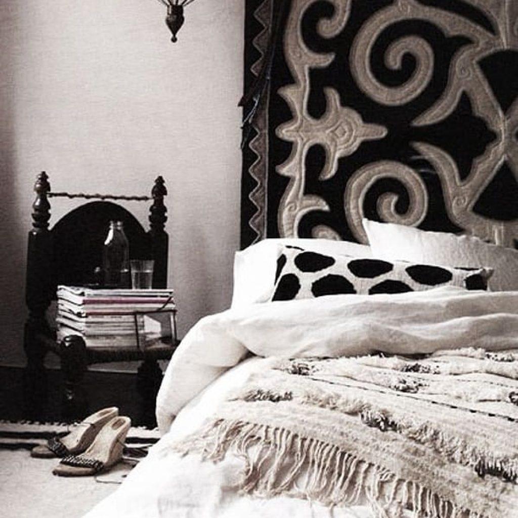 Black and beige headboard and mattress near wall
